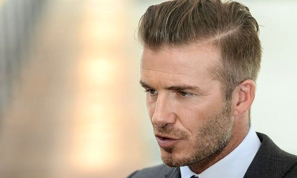 David Beckham ikut menolong wanita tua